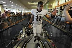 Vanderbilt quarterback Jordan Rodgers greets fans as he displays the team s  all-white uniform at Barnes   Noble on Wednesday. 2b16af10e